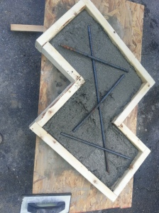After you mix the concrete pour into the mold and then you can add the rebar if you feel you need extra support