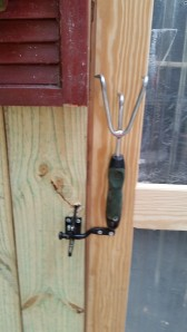 I made a handle from a cheap garden tool and had a gate latch hubby modified so that if someone gets 'locked in' the shed they can pull the special release and get out. He is brilliant!