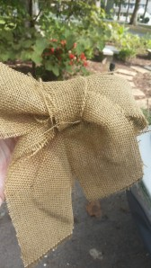 I had someone hold the burlap in the middle and tied a bow. had to mess with it until I got it the way i wanted