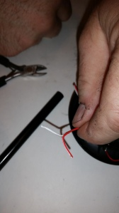 take the small wire cutters and carefully cut between the wires and pull apart