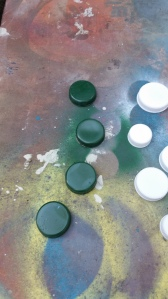 Spray painted white and green with Rustoleum 2x spray (used on plastic)