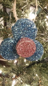 flower ornament with soda lid glued on the 3 milk jug lids- just one example of the creations