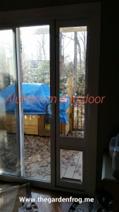 DIY scrap wood patio doggy door