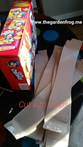 cut the cereal and other boxes into strips that are as deep as the gift box