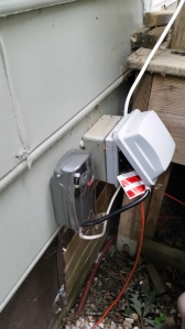We had an outdoor outlet already by the deck. the timer plugs in to the electrical box and the white cord for the light is measured from the outlet to the box where the sensor is and add about 5 inches of extra wire/cord